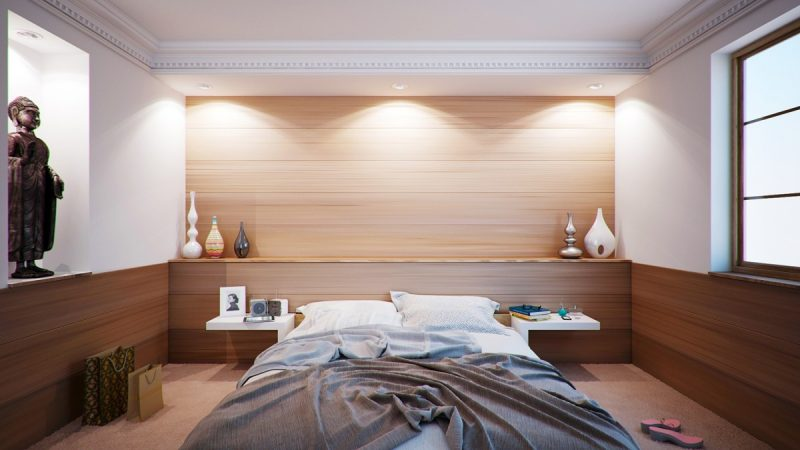 how should a mattress fit on a bed frame
