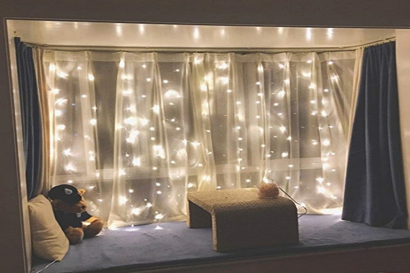 how to hang lights behind curtains