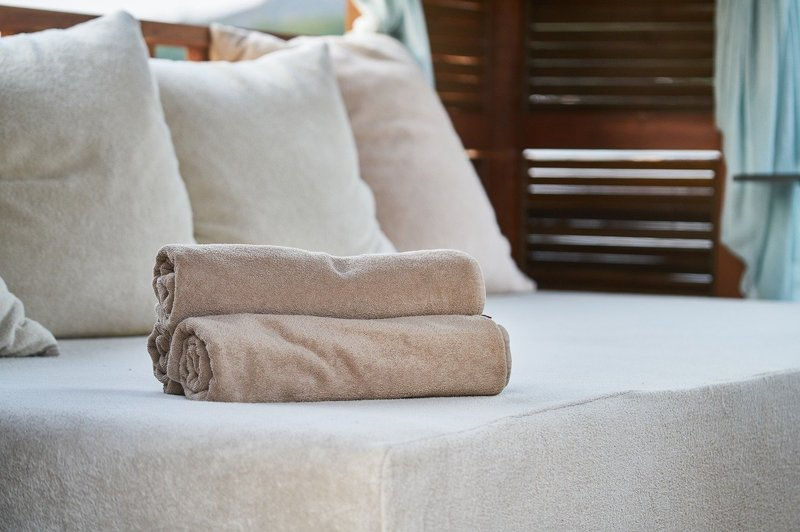 how to style a throw blanket on a bed